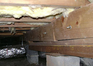 sagging crawl space with wooden shimming a Kings Beach crawl space