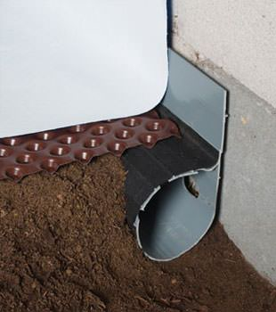 Closeup of a crawl space drainage system installed in Chilcoot