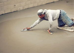 smoothing out the grout in a slab releveling project in Gardnerville