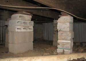 crawl space repairs done with concrete cinder blocks and wood shims in a Stateline home