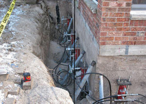 Foundation push piers installed around a house with a foundation settlement issues in Chilcoot
