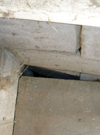 inward rotation of a foundation wall damaged by street creep in a garage in Doyle