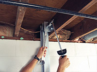 Straightening a foundation wall with the PowerBrace™ i-beam system in a Dayton home.
