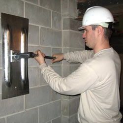installing a wall anchor to repair an bowing foundation wall in Dayton