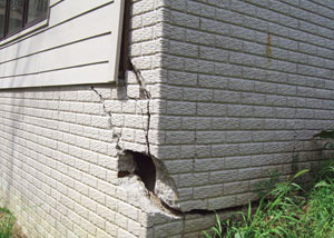 A severely damaged foundation wall in Fernley