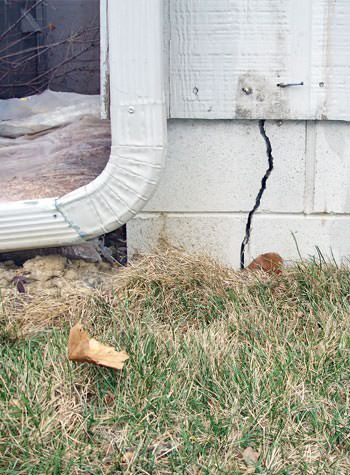 foundation wall cracks due to street creep in Doyle