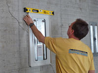 Positioning a wall plate cover on a foundation wall in Gardnerville.